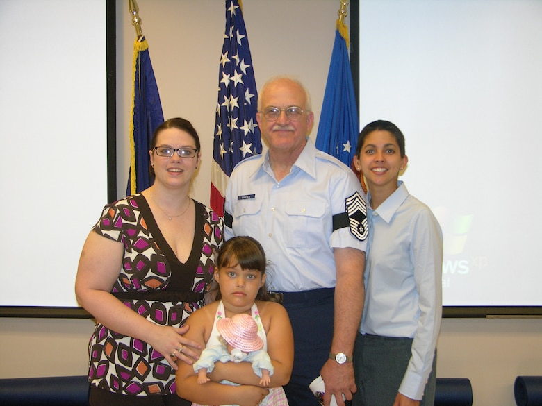 AOG The newly promoted Chief Baxter shares the spotlight with his daughters, Kristen Clark and Jennifer Baxter, and his granddaugther, Breanna Clark (Photo by Master Sgt. Brenda Shepard, 152nd)