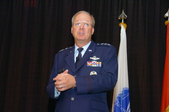 Lt. Gen. Craig McKinley, the director of the Air National Guard, tells 1,500 people gathered for the largest-ever National Guard Bureau Joint Family Program Volunteer Workshop and Youth Symposium in St. Louis, Mo., on July 21, 2008, that, ?What I?ve seen in my 2?-years as the director of the Air National Guard is a far more connected National Guard, a Guard that the adjutants general have brought together so that the talents of both Soldiers and Airmen can be brought to a mission and operate seamlessly.? The secretary of defense has nominated McKinley to be the next chief of the National Guard Bureau and to be the National Guard?s first four-star general. (U.S. Army photo by Staff Sgt. Jim Greenhill) (Released)