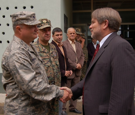 U.S. Ambassador to Bosnia-Herzegovina Charles English shakes hands with the Lt. Col. John McVicker, commander of the Maryland Air National Guard's 175th Civil Engineer Squadron during a visit to the Vuk Karadzic primary school in Vlasenica, Bosnia-Herzegovina July 24, 2008. The school was in the process of being renovated by members of the Maryland National Guard as part of a humanitarian civic action project under the auspices of the National Guard's State Partnership Program. (U.S. Air Force photo by Tech. Sgt. David D. Speicher)
