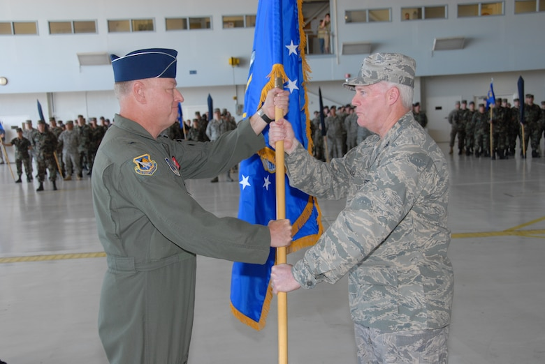The 181st Fighter Wing, Terre Haute, Ind., conducted a redesignation ceremony on 13 July, 2008 officially marking its transition from flying jets to processing intelligence and providing ground support to air operations at forward locations. Brig. Gen. Richard Clevenger, Indiana Air national Guard Commander, presents Col. Jeffrey Hauser, Wing Commander, new unit flag. U.S. Air force photo by TSgt Michael W. Kellams.