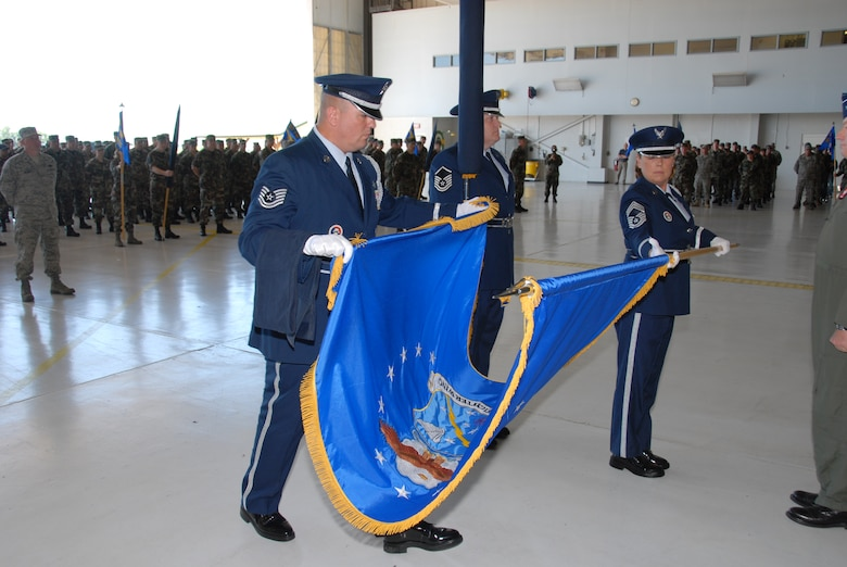 The181st Fighter Wing, Terre Haute, Ind., conducted a redesignation ceremony on 13 July, 2008 officially marking its transition from flying jets to processing intelligence and providing ground support to air operations at forward locations. Honor guard members retire unit flag. U.S. Air force photo by TSgt Michael W. Kellams.