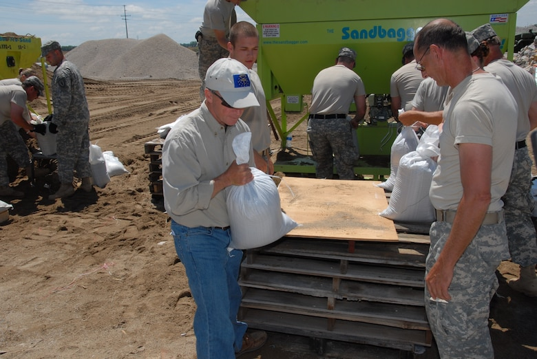 Governor Mitch Daniels assisting Guardsmen in sandbag operations at; Vincennes Indiana Department of Transportation on Tuesday; 10 June 2008. (U.S. Air Force photo by Senior Master Sgt. John S. Chapman)
