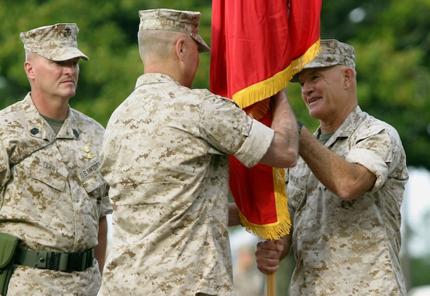 Maj. Gen. Dennis J. Hejlik (right) relinquishes the U.S. Marine Corps Forces, Special Operations Command Colors to Maj. Gen. Mastin M. Robeson during a change of command ceremony here, July 24. Robeson assumed command of MARSOC, while Hejlik took over command of II Marine Expeditionary Force, July 25.