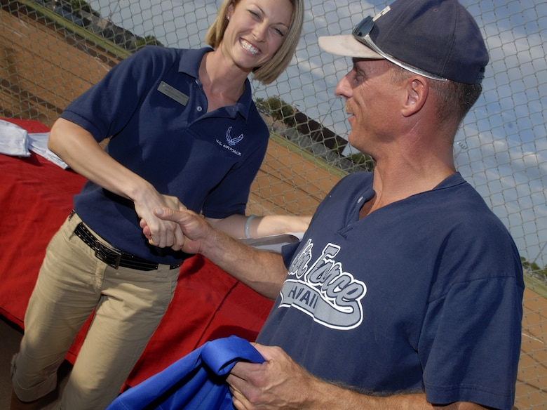 Charlie Rehburg, of the 17th Mission Support Group Junkyard Dogs, receives congratulations on being voted overall MVP for the 2008 Softball season by Goodfellow's Sports Director Michelle Ammon. Rehburg was awarded a plaque and commemorative jersey for his outstanding athleticism. (U.S. Air Force photo by Senior Airman Kamaile Chan)