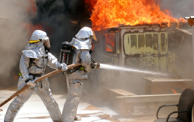 JOINT BASE BALAD, Iraq -- Firefighters battle to control a blaze here that destroyed six metal framed buildings used as workspace, storage and living quarters July 22. No injuries were reported from the fire, but a high temperature of 117 degrees forced three firemen to be treated at the Air Force Theater Hospital for heat stress-related injuries, they were later released. The cause of the fire is under investigation. (U.S. Army photo/Sgt. Gary Hawkins)