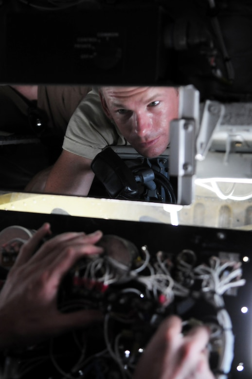 MANAS AIR BASE, KYRGYZ REPUBLIC -- Tech. Sgt. Jeremy Metzger, 376th Expeditionary Aircraft Maintenance Squadron, replaces a lighting transformer on a KC-135 here, July 23. The KC-135 Stratotanker provides the core aerial refueling capability for the United States Air Force and has excelled in this role for more than 50 years. (U.S. Air Force photo / Airman 1st Class Ruth Holcomb)