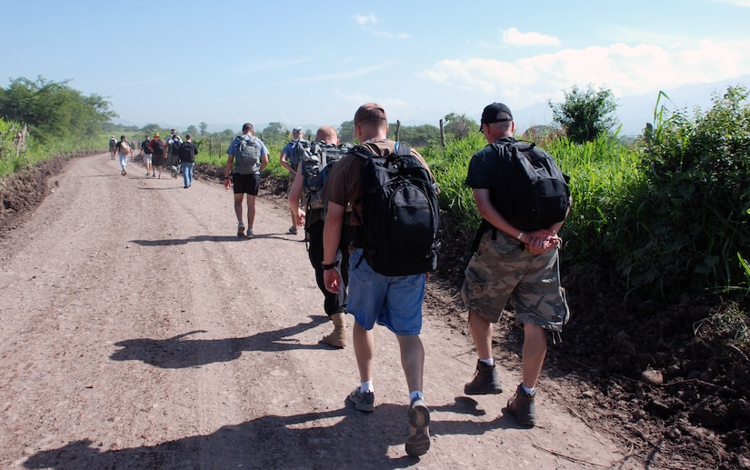 Military members and civilians from Joint Task Force-Bravo hike food into Mira Valle village in Honduras. The group of more than 100 people packed in nearly 1.600 pounds of food to the village. (U.S. Air Force photo by Tech. Sgt. John Asselin)