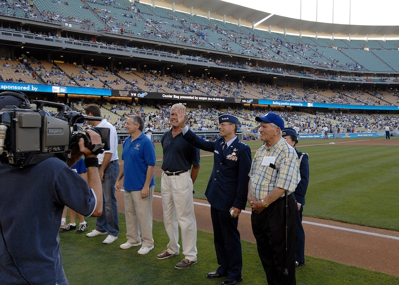 Lt. Gen. Tom Scheridan (second from right, front row), Space and Missile Systems Center commander, waves to the crowd after being introduced at the start of the Dodger game celebrating the city of El Segundo, July 26. (Photo by Stephen Schester)