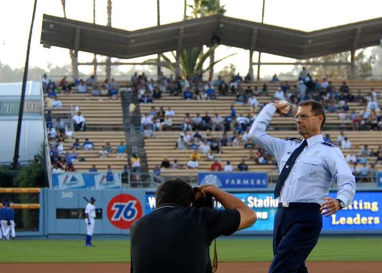 Lt. Gen. Tom Scheriden, Space and Missile Systems Center commander, throws the ceremonial first pitch at the Dodger Game celebrating the El Segundo community as a local photographer takes his photo, July 26. (Photo by Stephen Schester)