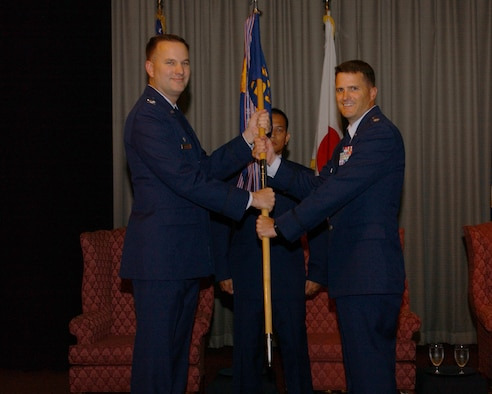 Lt.Col. J. Kelly Klein receives command of the 374th Medical Support Squadron   during a change of command ceremony on 25 July.(United States Air Force by Airman Devin Doskey)