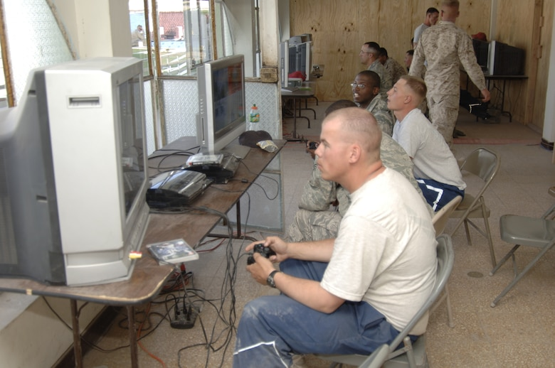 Task Force New Horizon members enjoy a break from their every day deployment duties by playing video games in the Morale, Welfare and Recreation area, July 28.  Air Force Services provide task force members the opportunity to play video games, watch movies, go on trips to downtown Ayacucho, surf the Internet and call home.  (U.S. Air Force photo/Capt. David Tomiyama)