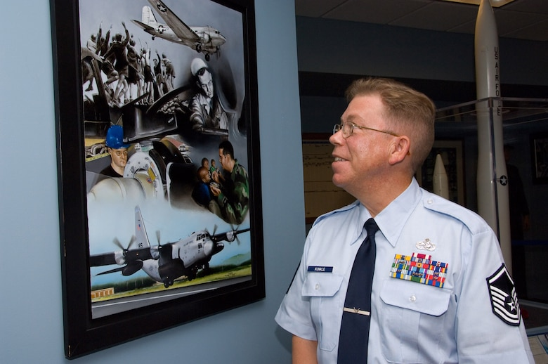 Master Sgt. Jeffrey Kunkle recently donated his original painting to Gunter's Enlisted Heritage Hall airlift exhibit. The sergeant, of the 86th Maintenance Squadron at Ramstein Air Base, Germany, recently attended the Air Force Senior NCO Academy and has promised to do more works of art for the museum.  (Air Force photo by Melanie Rodgers)