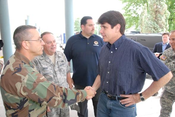 Illinois Governer Rod Blagojevich greets Illinois Air National Guard Col. Rick Nyalka at the Joint Task Force - South headquarters in Alton, Ill.  Nyalka is the military commander of the JTF-S which is responsible for supplying the area with Illinois National Guard personnel and equipment as they battle the flooding of the MIssissippi river. (photo by U.S. Air Force Master Sgt. Ken Stephens)