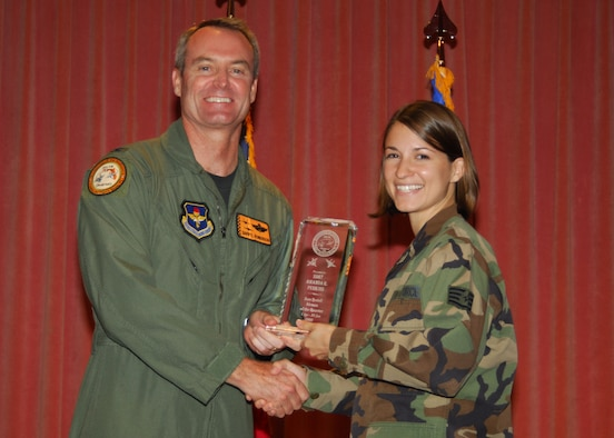 SSgt Amanda Perkins receiving the Tyndall Airman the Quarter award from Col Roberson of the 325th wing at the Quarterly Awards Luncheon July 28, 2008. Photo by Lisa Norman.
