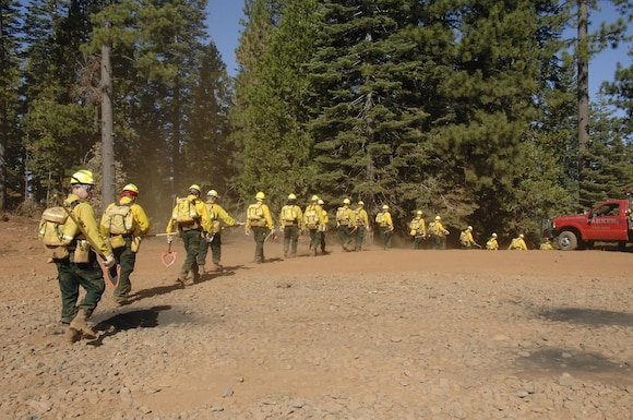 Members from the 129th Rescue Wing, 144th Fighter Wing, 146th Airlift Wing, 163rd Reconnaissance Wing, and 162nd Combat Communications Group, California Air National Guard, head out to the forest outside of Paradise City, Calif. to conduct fireline training during Operation Lightning Strike July 27.  More than 200 Airmen from across California completed their four-day firefighting training and deployed July 30 to the Telegraph Fire near Yosemite National Forest north of Fresno. (U.S. Air Force photo by Master Sgt. Dan Kacir)