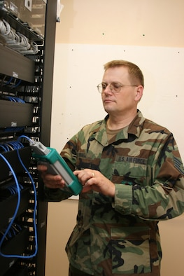 Staff Sgt. Kalvin Donnell, a 189th Communications Flight a voice network systems craftsman, troubleshoots a local-area network patch.
