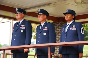 From left, Lt. Gen. Craig R. McKinley, director of the Air National Guard, Col. Michael L. Waggett, commander of the Air Guard's I.G. Brown Training and Education Center (TEC) and Chief Master Sgt. Deborah Davidson, TEC enlisted education commandant, watch a pass and review of Noncommissioned Officer Academy students July 31 during the TEC's 40th anniversary celebration at McGhee Tyson Air National Guard Base, Tenn. (Photo by Air Force Tech. Sgt. Kendra Owenby, Tennessee National Guard)