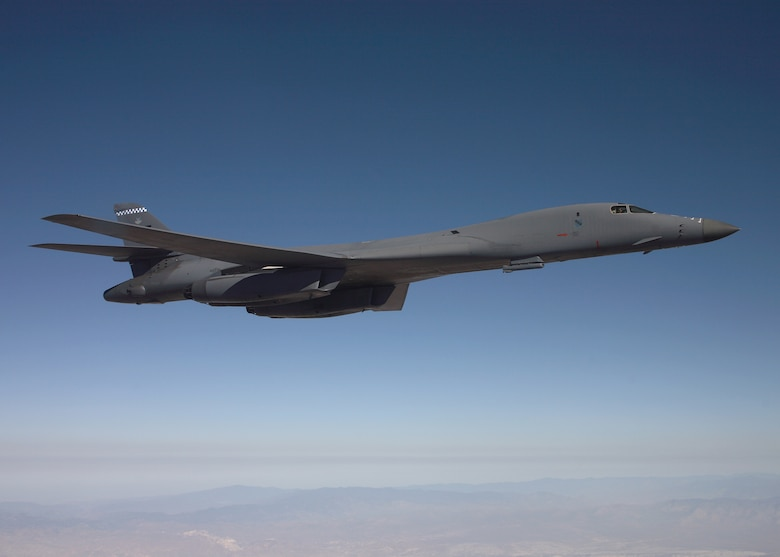 A B-1B Lancer flies on a testing mission carrying a sniper pod. The sniper pod is scheduled to be fully operational by summer. (Air Force photo by Jet Fabara)