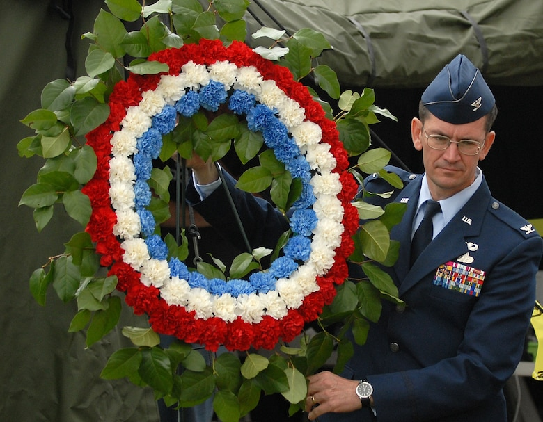 61st Air Base Wing Commander Col. Joseph Schwarz lays a wreath in remembrance of military dead at the annual Memorial Day observance at Green Hills Memorial Park in Rolling Hills, May 26. (Photo by Stephen Schester)