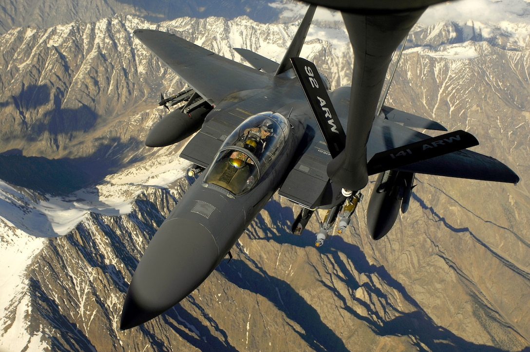 An Air Force F-15E Strike Eagle aircraft moves into position to receive fuel May 29, 2008 from a KC-135 Stratotanker during a mission over Afghanistan. The F-15E is deployed from Royal Air Force Lakenheath, U.K. and the KC-135 is assigned to the 22nd Expeditionary Air Refueling Squadron, 376th Air Expeditionary Wing Manas Air Base, Kyrgyzstan and is deployed from 141st Air Refueling Wing Fairchild Air Force Base, Wash. (U.S. Air Force photo/Master Sgt. Andy Dunaway)