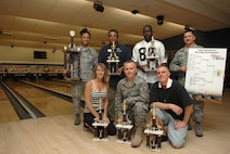 """Members of the 57th Aircraft Maintenance Squadron's, team """"Thunderstruck"""" displays their trophy's as the 2008 Nellis Air Force Base intramural bowling champions May 28, 2008 Nellis AFB, Nev.  (U.S. Air Force Photo/Senior Airman Larry E. Reid Jr.)"""