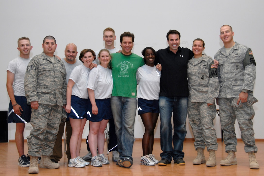 SOUTHWEST ASIA -- Comedians Robert Kelly, third from left, Dane Cook, center, and Al Del Bene, third from right, take a group photo with Airmen deployed to the 386th Air Expeditionary Wing after a comedy show May 30, 2008, at an air base in the Persian Gulf Region. Comedians Al Del Bene, Robert Kelly, and Dane Cook are visiting deployed troops throughout the area of responsibility during a five-day United Service Organizations sponsored Combat Comedy Tour. (U.S. Air Force photo/ Staff Sgt. Patrick Dixon)