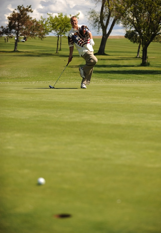 MOUNTAIN HOME AIR FORCE BASE, Idaho - Senior Master Sgt. Carl Brazier, 366th Aircraft Maintenance Squadron, tries to coax the ball into the hole on a 50-foot putt during the Operation Warmheart Golf Tournament at Silver Sage Golf Course May 30. Operation Warmheart is a program run by the Mountain Home Air Force Base first sergeants to raise money in support of local Gunfighter families and other members of the local communities. Operation Warmheart also holds a softball tournament, a holiday food drive and numerous other fund raisers to support this community. (U.S. Air Force photo/ Airman 1st Class Ryan Crane)