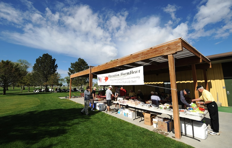 MOUNTAIN HOME AIR FORCE BASE, Idaho - Participants in the Operation Warmheart Golf Tournament enjoy hamburgers and hotdogs prior to teeing off at Silver Sage Golf Course May 30. Operation Warmheart is a program run by the Mountain Home Air Force Base first sergeants to raise money in support of local Gunfighter families and other members of the local communities. Operation Warmheart also holds a softball tournament, a holiday food drive and numerous other fund raisers to support this community. (U.S. Air Force photo/ Airman 1st Class Ryan Crane)