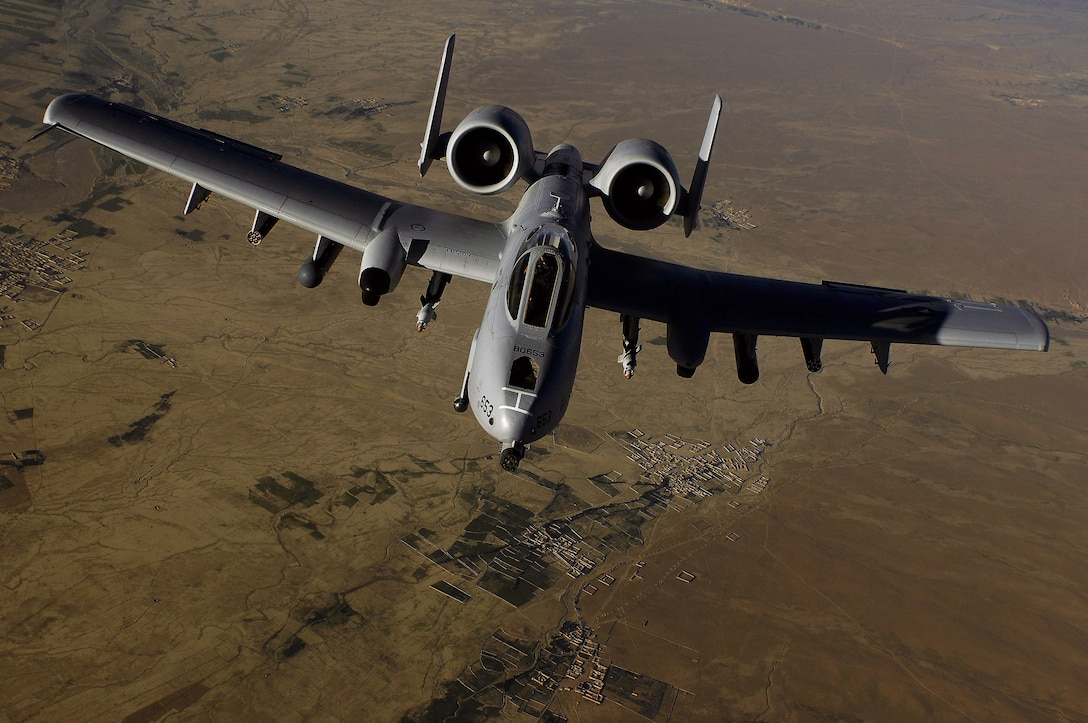 "An Air Force A-10 Thunderbolt II flown by a pilot from the 303rd Fighter Squadron moves into position to receive fuel May 29, 2008, from a KC-135 Stratotanker during a mission over Afghanistan. The aircraft belongs to the Idaho Air National Guard, but is being flown by an Air Force Reserve pilot during a ""split"" deployment between the Reserve and two Air National Guard units.  The 303rd is part of the 442nd Fighter Wing, based at Whiteman Air Force Base, Mo.  (U.S. Air Force photo/Master Sgt. Andy Dunaway)"