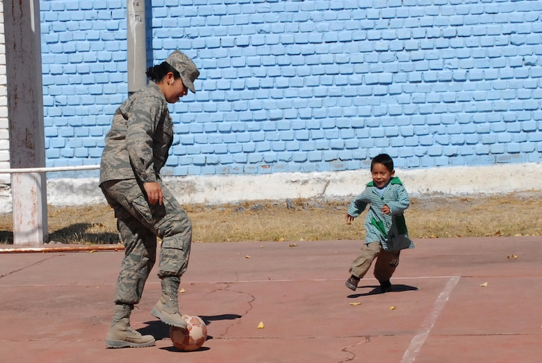 U.S. Air Force 1st Lt. Mary Pekas,  the public affairs officer assigned to Task Force New Horizons Peru, deployed from Davis-Monthan Air Force Base, Ariz., enjoys a game of soccer with Diego Omar Palomino Guerrero, 5, during a visit to I.E. Inicial CRL. Miguel Peñarrieta Elementary School June 4 in Los Cabitos, Peru, the location at which U.S. military members are based in support of New Horizons Peru 2008, a humanitarian event that benefits thousands of Peruvians. (U.S. Air Force photo/ Airman 1st Class Tracie Forte)