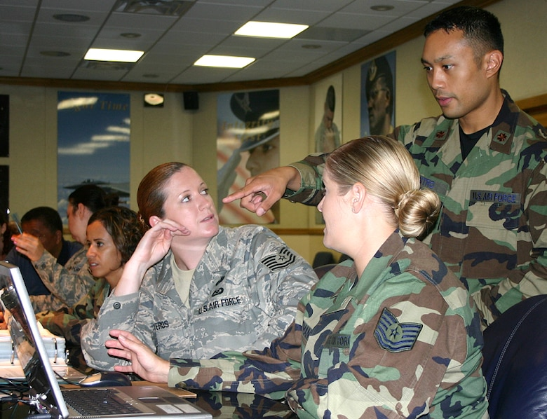 Tech. Sgt. Jennifer Ontiveros (left), Tech. Sgt. Sherri Guzman and Maj. Erick Castro, from the Air Force Personnel Center here at Randolph Air Force Base, Texas, discuss a question from a personnelist in the field during one of the center's recent webcasts.  The intent of the monthly Internet conferences is to provide details on upcoming personnel programs and procedures for military and civilian personnelists across the Air Force.  (Courtesy photo)