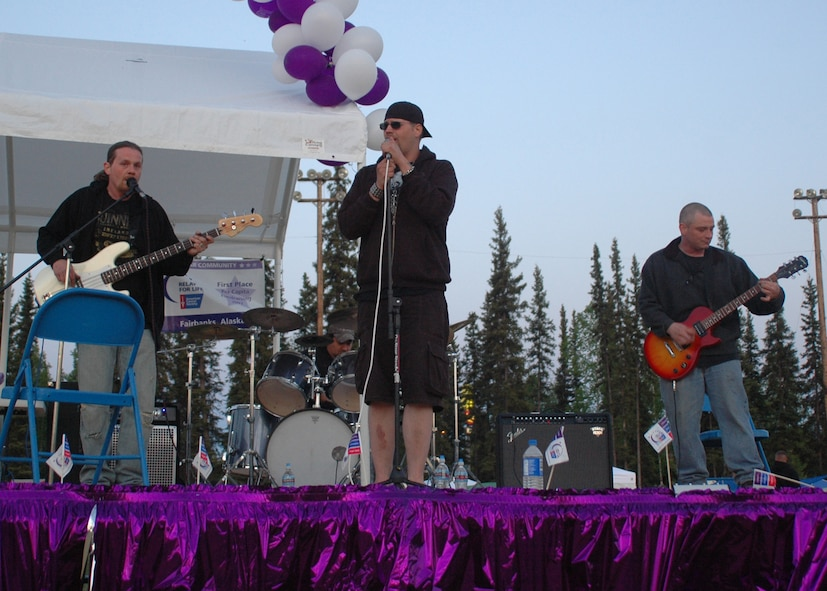 Tech. Sgt. John Kehres, 354th Aircraft Maintenance Squadron weapons crew chief, (far right) plays guitar with his band, Dystopia, at a cancer benefit May 31, 2008, at the West Valley High School in Fairbanks. Sergeant Kehres and his band mates, brothers Justin (vocals) and Rob Smith (bass guitar), and Mitch Higgins (drums), met in 1992 during Sergeant Kehre?s first tour at Eielson. In 1999 Sergeant Kehres got reassigned to Pope AFB, N.C., but came back to Eielson afterwards and has been here with his family ever since. (U.S. Air Force photo by Airman 1st Class Nora Anton)