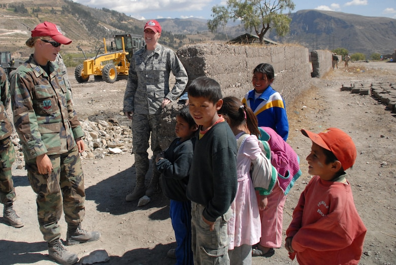 U.S. Air Force Captains Stacy Nimmo and Megan Leitch, both deployed from the 820th RED HORSE Squadron at Nellis Air Force Base, Nev., converse with the children of Yanama, Peru during a visit to the construction site for a school being built in support of New Horizons Peru 2008, a humanitarian event that benefits thousands of Peruvians. Nearly 300 members from the U.S. Air Force, Army, Marines, and Navy came together to provide Peruvians with new schools, clinics, and water wells. (U.S. Air Force photo/Airman 1st Class Tracie Forte)