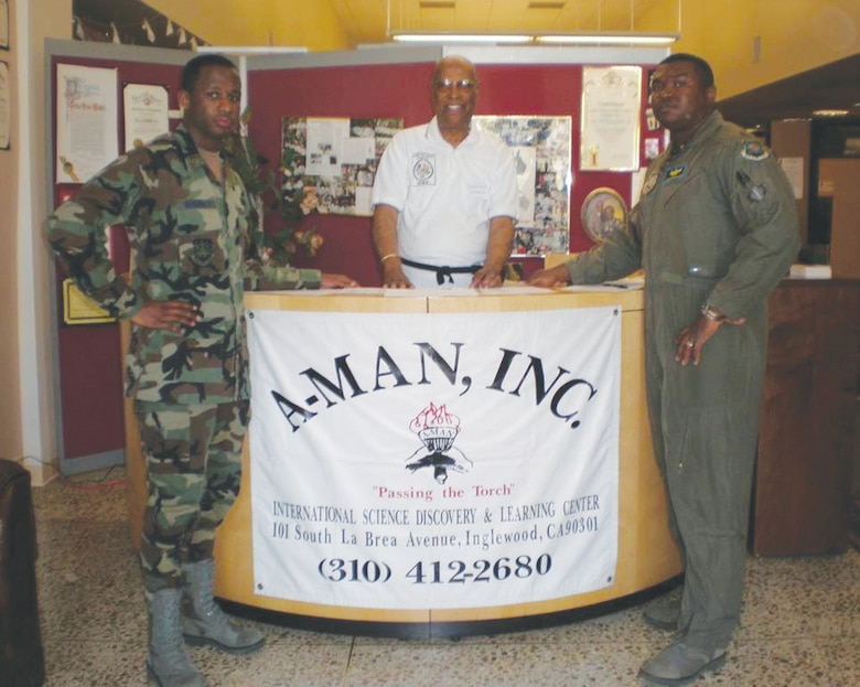 Maj Jermaine Brinson and Lt Rashim McKinney and Hal Walker Jr., co-founder, African-American Male Achievers Network (A-MAN), Inc. stand at the A-MAN booth during the  International Science Discovery and Learning Center in Inglewood, Calif.  (photo by Terita R. Norton, Aerospace Corporation)