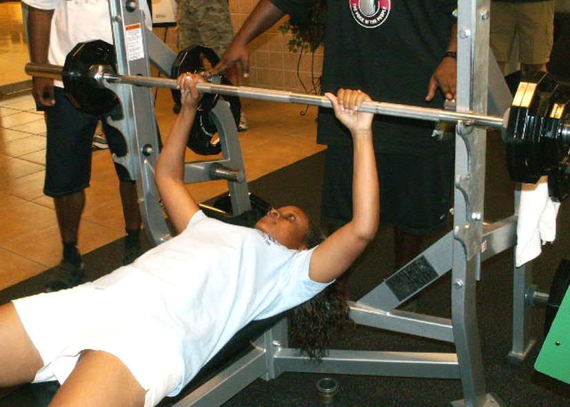 Staff Sgt. Keisha Sallee from the Air Force Personnel Center here at Randolph Air Force Base, Texas, bench presses one repetition of 110 lbs. to win the title in her weight division as part of AFPC's sports day. Sergeant Sallee is from the directorate of assignments, this year's overall champion. (US Air Force photo/Master Sgt. Kat Bailey)