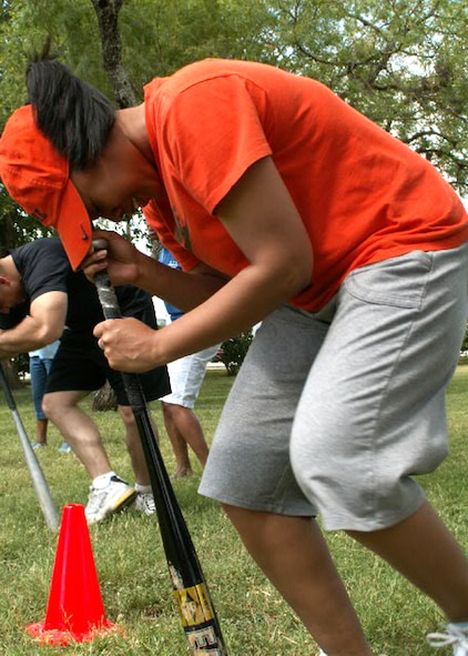 Tech. Sgt. Andrea Hall goes a little batty during the Air Force Personnel Center's sports day here at Randolph Air Force Base, Texas, June 4. Sergeant Hall's team, from personnel services, earned third place in the dizzy bat relay. Dizzy bat was just one of the many wacky and traditional sporting events chosen to boost morale and esprit de corps within AFPC. (US Air Force photo/Master Sgt. Kat Bailey)