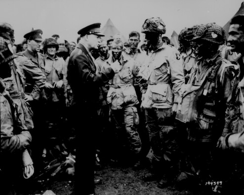 """U.S. NATIONAL ARCHIVES -- General Eisenhower gives the order of the day """"Full victory - Nothing else"""" to paratroopers in England just before they board airplanes in the first D-Day assault. More than 1,000 transport aircraft dropped paratroopers to secure the flanks and beach exits. (courtesy photo)"""