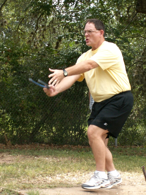 Maj. Aldo Cahue from the directorate of air and space expeditionary force operations pitches horseshoes during the Air Force Personnel Center's sports day here at Randolph Air Force Base, Texas, June 4. (US Air Force photo/Master Sgt. Kat Bailey)