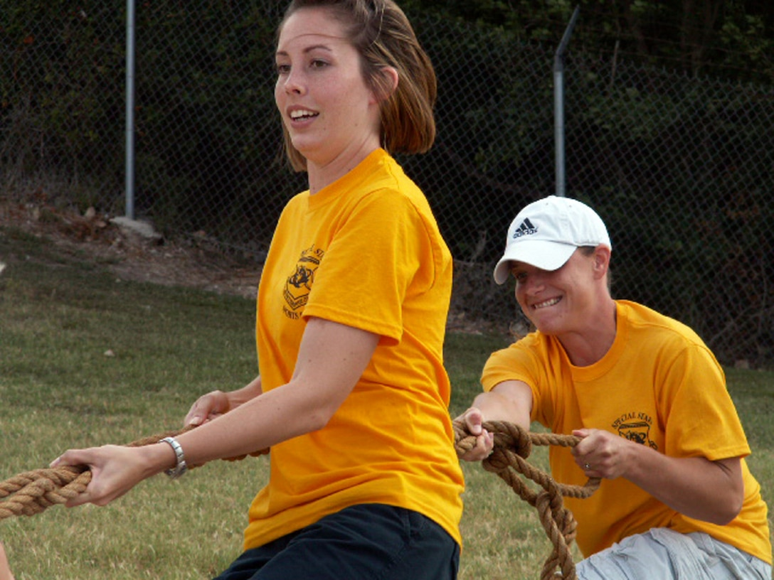 Senior Airman Brittney Nanchy (left) and Staff Sgt. Sunshine Scarborough dig their heels in during a muscle-straining round of Tug-o-War during the Air Force Personnel Center's sports day here at Randolph Air Force Base, Texas, June 4. Both Airmen are personnelists on the commander's support staff. Their directorate, Special Staff, won third place overall in the women's division. (US Air Force photo/Master Sgt. Kat Bailey)