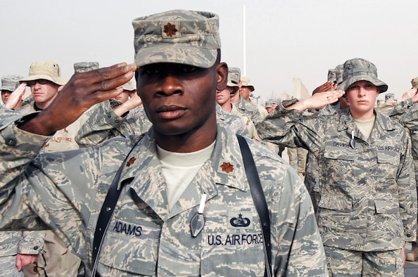 Maj. Terrence Adams salutes during a retreat ceremony May 15 at Ali Base, Iraq. Major Adams was born and raised in Tuskegee, Ala., and is now deployed to a unit in the 332nd Air Expeditionary Wing where the Tuskegee legend continues. Major Adams is the 407th Expeditionary Communications Squadron commander deployed from Tinker Air Force Base, Okla. (U.S. Air Force photo/Tech. Sgt. Sabrina Johnson)