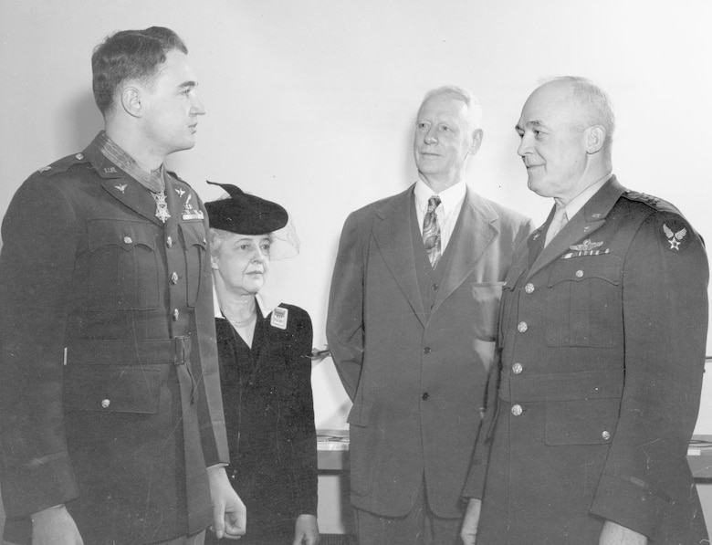 "Gen. ""Hap"" Arnold presenting the Medal of Honor to Zeamer as his parents look on. (U.S. Air Force photo)"