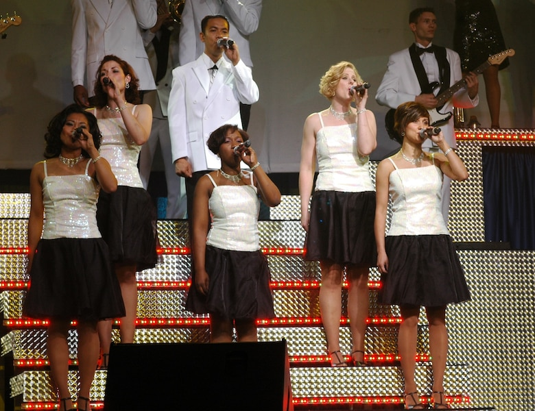 Tech. Sgt. Chandra Smith (front right) harmonizes with fellow Tops in Blue members during a performance June 4. Smith is a member of the Arizona Air National Guard's 162nd Fighter Wing. (Air National Guard Photo by Capt. Gabe Johnson)