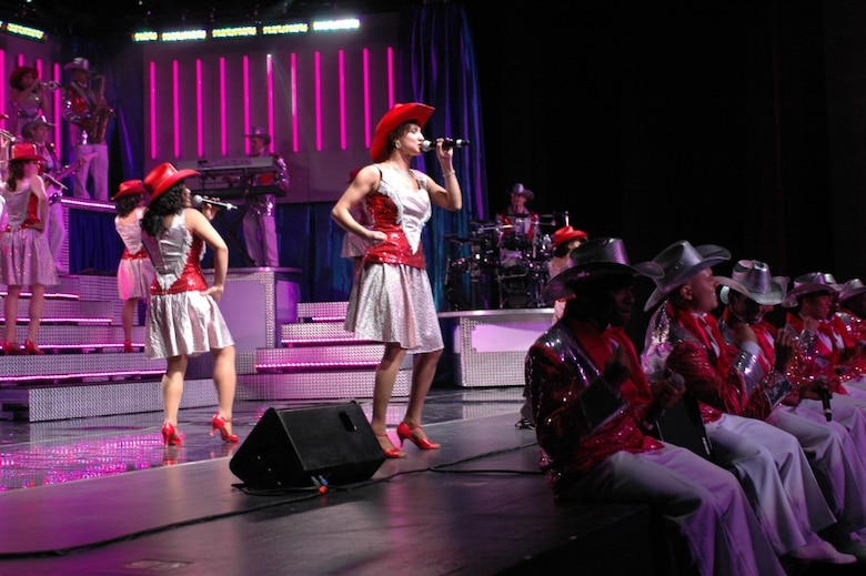 Tech. Sgt. Chandra Smith sings for her hometown crowd at the Tucson Convention Center June 4. Tops in Blue's 2008 show featured a member of the Arizona Air National Guard's 162nd Fighter Wing. (Air National Guard Photo by Capt. Gabe Johnson)