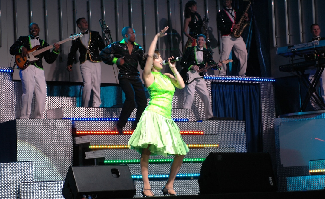 """Tech. Sgt. Chandra Smith sings Gloria Estefan's """"Rhythm Is Gonna Get You"""" as a member of Tops in Blue, June 4. The performance team's 2008 show in Tucson featured a member of the Arizona Air National Guard's 162nd Fighter Wing. (Air National Guard Photo by Capt. Gabe Johnson)"""