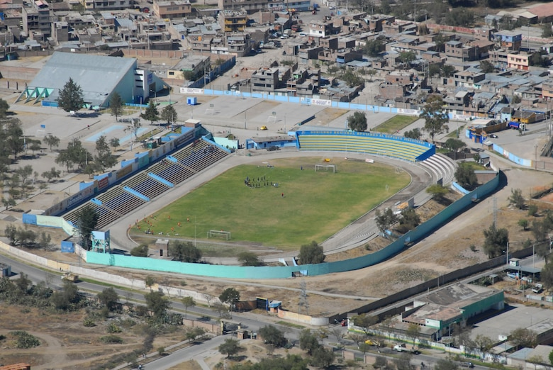 Peruvians play soccer at a stadium in Ayucucho, Peru, the region where U.S. servicemembers are building clinics and schools in support of New Horizons Peru 2008, a humanitarian event that benefits underprivileged Peruvians. (U.S. Air Force photo/Airman 1st Class Tracie Forte)