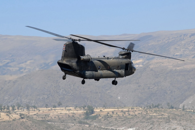 A CH-47 Chinook flies over Ayucucho, Peru, the region where U.S. servicemembers are building clinics and schools in support of New Horizons - Peru 2008, a humanitarian event that benefits underprivileged Peruvians. (U.S. Air Force photo/Airman 1st Class Tracie Forte)