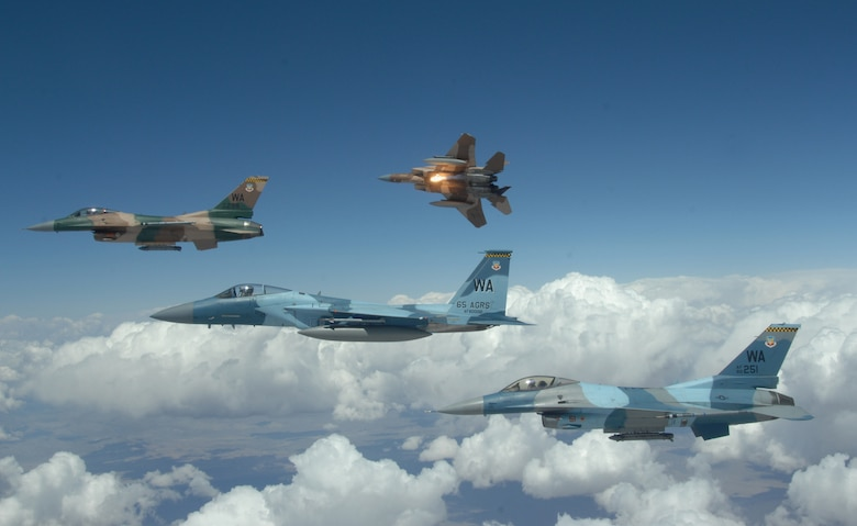 A flight of Aggressor F-15 Eagles and F-16 Fighting Falcons fly in formation over the Nevada Test and Training Ranges on June 5, 2008. The jets are assigned to the 64th and 65th Aggressor Squadrons at Nellis Air Force Base, Nev. The Aggressor mission is to prepare the combat air forces, joint and allied aircrews for tomorrowÕs victories with challenging and realistic threat replication, training, academics and feedback.