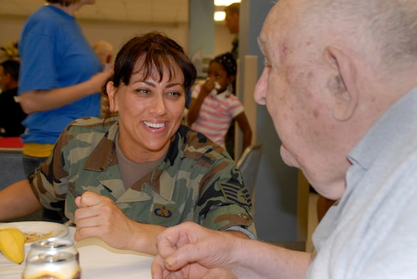 WRIGHT-PATTERSON AFB, Ohio - Staff Sergeant Tame Marshall, 445th Aircraft Maintenance Squadron, talks with a VA resident during the annual Air Force Sergeant's Association picnic June, 7, 2008, at the Veterans Affairs Medical Center in Dayton, Ohio.  Reservists from the 445th Airlift wing support the event every year and enjoy hearing and sharing stories with the VA residents. (U.S. Air Force photo/Tech. Sgt. Charlie Miller)