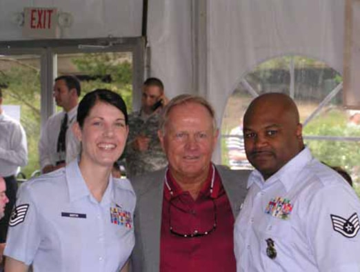 """Tech. Sgt. Christine Martin from Finance, left, and Staff Sgt. Jeffrey Roberts, right, from Security Forces Squadron were with golf legend Jack Nicklaus at the 2008 Memorial Golf Tournament's """"Military Appreciation Day."""