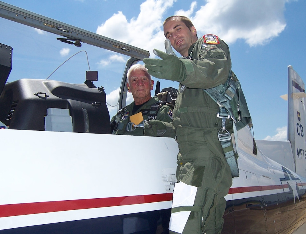 """Captain Josh Higgins, 41st Flying Training Squadron Instructor Pilot, briefs Col. Carlyle """"Smitty"""" Harris before his T-6 flight June 6. Colonel Harris was the keynote speaker for the graduation for Specialized Undergraduate Pilot Training class 08-10. (U.S. Air Force photo by Sonic Johnson)"""